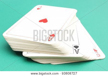 Stack Of Game Cards On Green Background