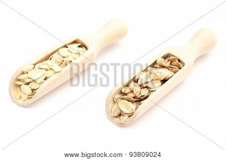 Heap Of Oatmeal And Rye Flakes On Wooden Spoon. White Background