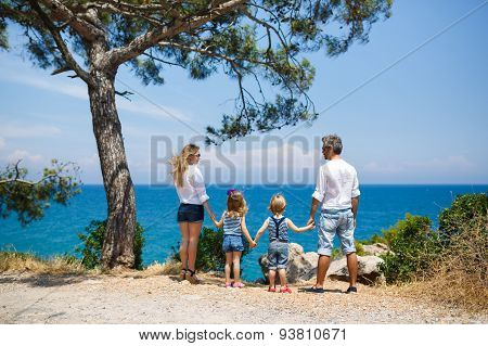 Family With Two Kids On The Seacoast