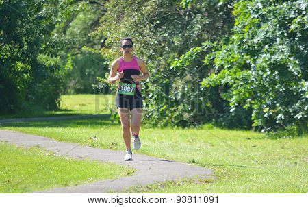 Female Triathlon runner in park