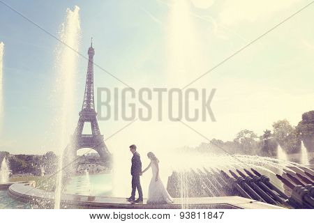 Bride And Groom Having Fun At Fountain In Paris