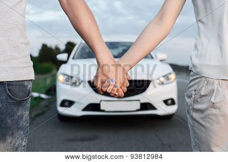 Lovely couple near the car