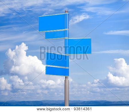Blank signs in blue color against sky