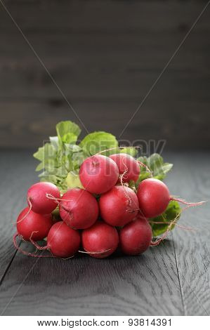 freshly harvested radishes on rustic table