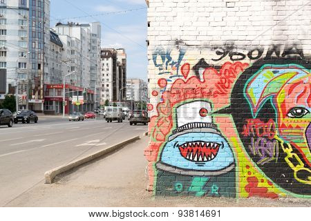 Urban Graffiti On A Wall With Traffic