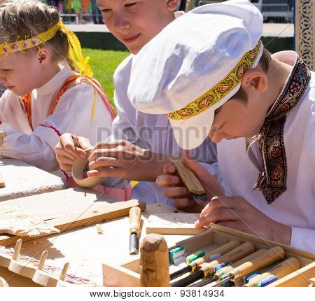 Young Children In Russian Unifrom At Craft Fair