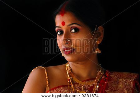 Indian woman with gold jewelery