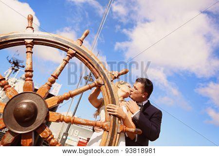 Bride And Groom Holding Old Boat Steering Wheel