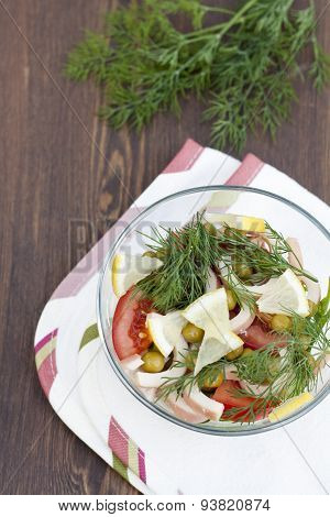 Salad of cooked squid, fresh vegetables and herbs