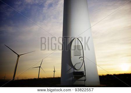 Windmills for electric power production at sunset, Pozuelo de Aragon, Zaragoza, Aragon, Spain
