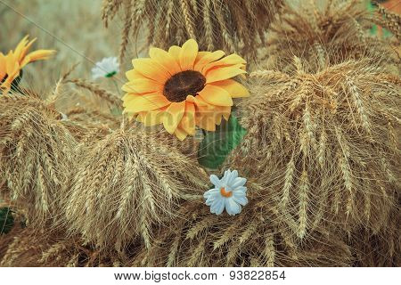 Decoration Of Artificial Flowers And Ears Of Corn.