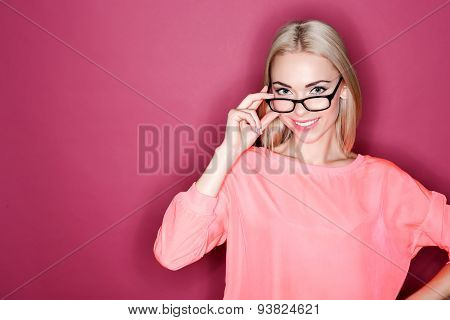 Blond-haired woman posing with glasses