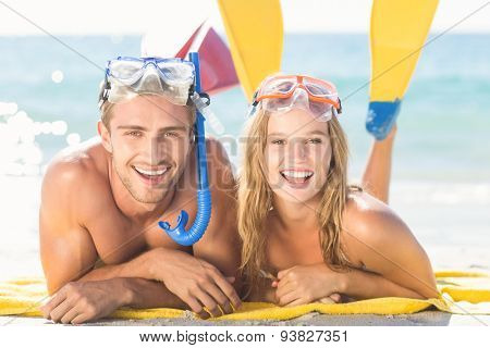 Happy couple with snorkel and flippers at the beach