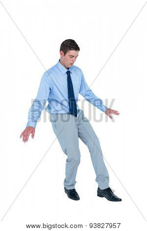 Concentrated businessman walking on white background