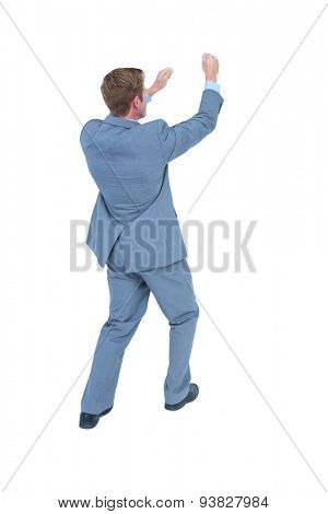 Businessman presenting with hands on white background