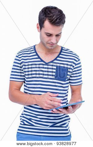Handsome hipster using tablet on white background