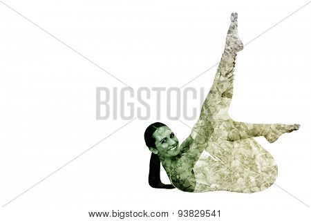 Fit woman stretching body in fitness studio against autumn leaves on the ground