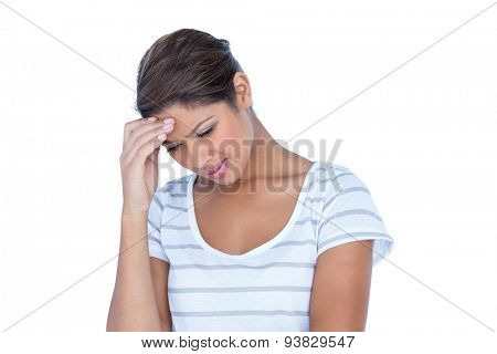 A sad brunette with headache on white background