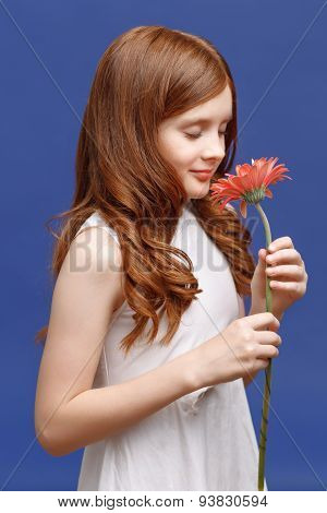 Pretty girl holding flower
