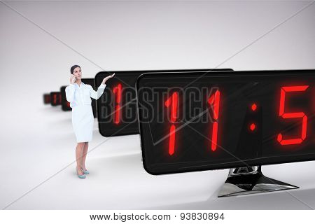 Businesswoman on the phone against grey background