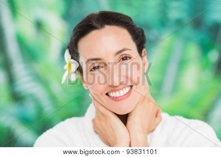a woman with a flower in her hair on a spa day