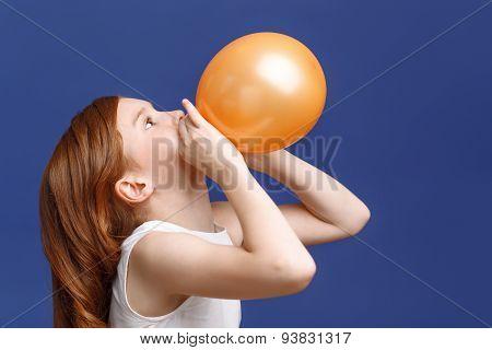 Nice girl inflating balloon