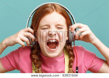 Pretty girl listening to music