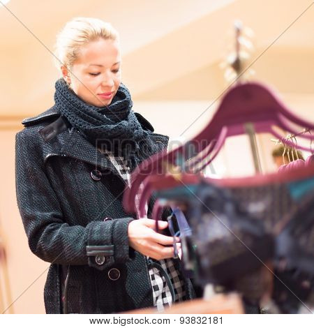 Beautiful lady shopping in lingerie store.