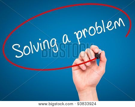 Man Hand writing Solving a problem with black marker on visual screen.