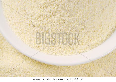 close up of grits in white soup plate