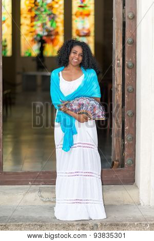 Beautiful young black cuban woman wearing a traditional dress
