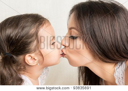 Happy Mother And  Daughter kissing