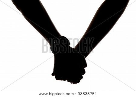 Silhouette of holding hands