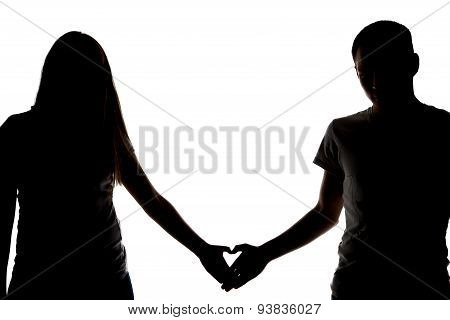 Silhouette of two teenagers showing heart