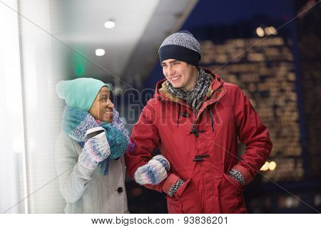 Multiethnic couple conversing at dusk during winter