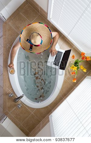 Man Relaxing In A Bath In A Mexican Sombrero