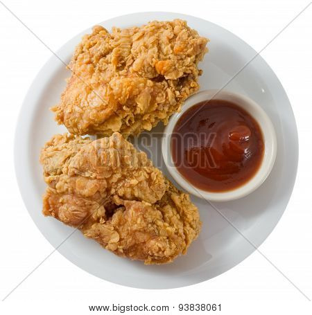 Deep Fried Chicken With Sauce On A White Dish