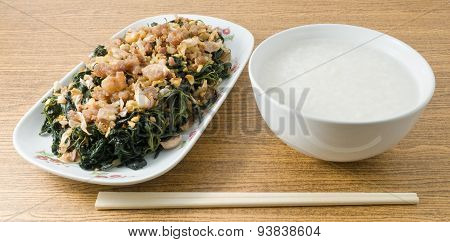 Stir Fried Jute Leaves Served With Rice Gruel