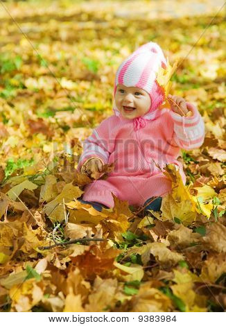Aby Girl Playing With Autumnal Leaves