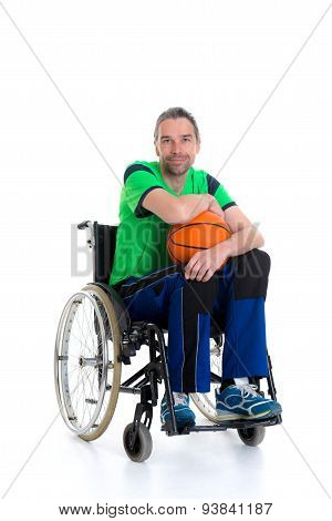 Disabled Man In A Wheelchair Is Doing Sport With Ball