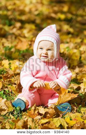 Kid  In Autumn Leaves