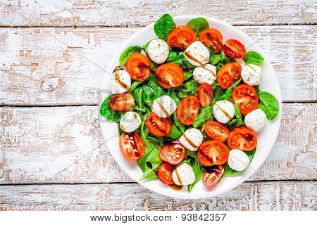 Salad Of Mozzarella, Cherry Tomatoes And Spinach With Balsamic Sauce