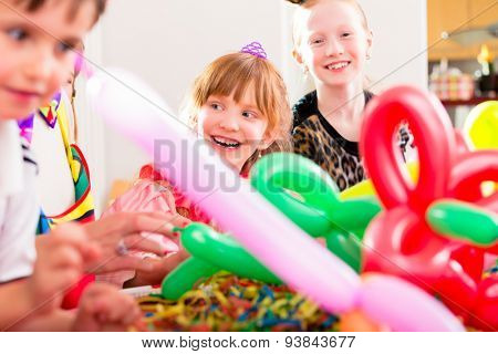Kids having birthday celebration with balloons