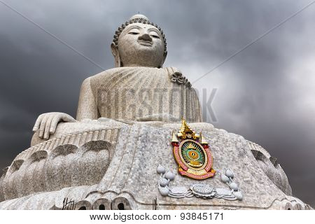The Phuket Big Buddha at the top of the hill under a stormy sky
