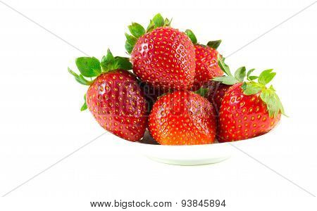 Several Strawberries On A Saucer
