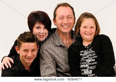 a young good looking family with teenage children smiling