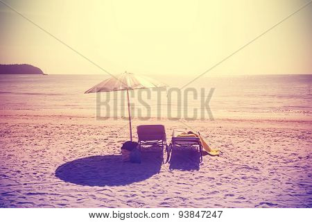 Vintage Instagram Stylized Beach Chairs And Umbrella At Sunset.