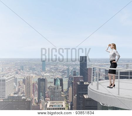 Business Lady Looks At The New York City Standing On The Top Of The Skyscraper Terrace.