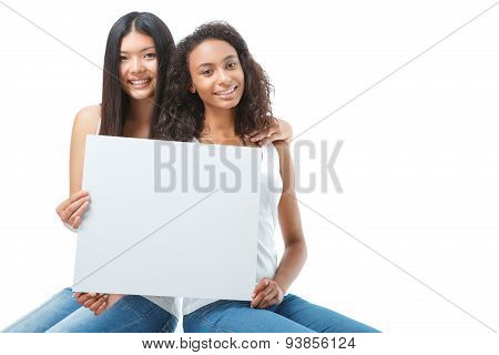 Nice ladies holding sheet of paper