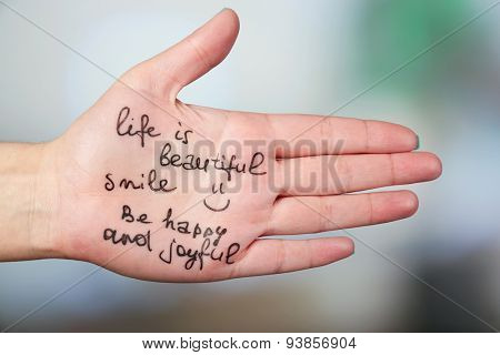 Female hand with written message on bright background